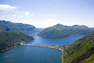 Panoramic view from Monte San Salvatore (912 m) over Motorway, Lake Lugano and Lugano, Ticino, Switzerland