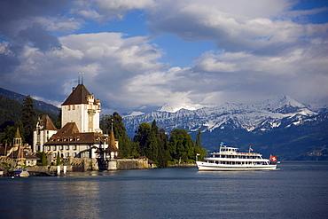 Boat arrivinig at Castle Oberhofen at Lake Thun, Oberhofen, Bernese Oberland (highlands), Canton of Bern, Switzerland