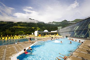 People bathing in a thermal outdoor pool, Alpen Therme Gastein, Bad Hofgastein, Gastein Valley, Salzburg, Austria