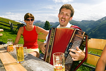 Man playing accordion, Bichlalm (1731 m), Grossarl Valley, Salzburg, Austria