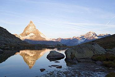 East side (Hoernligrat) of Matterhorn (4478 m) reflected in Riffelsee, Zermatt, Valais, Switzerland