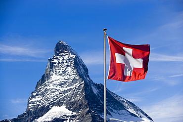 Swiss flag in front of the Matterhorn (4478 metres), Zermatt, Valais, Switzerland