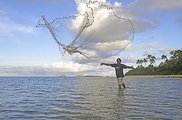 Fiherman throwing out fishnet, Fafa Island Resort, Tonga, South Seas