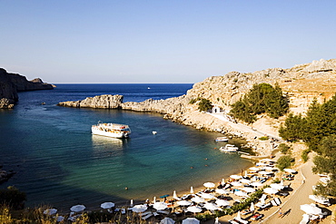 View over Saint Paul's Bay (Agios Pavlos) with excursion boat, Lindos, Rhodes, Greece