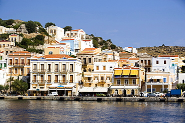 Mansions at quay of harbour Gialos, Simi, Symi Island, Greece
