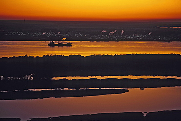 aerial photo of river Elbe at sunset, northern Germany, chemical plant