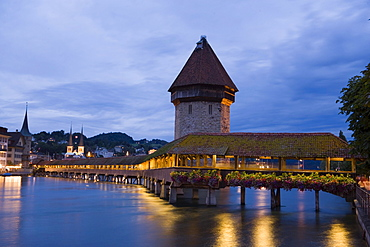 View over river Reuss with Kapellbruecke (chapel bridge, oldest covered bridge of Europe) to city hall in the evening, Lucerne, Canton Lucerne, Switzerland
