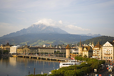 Seebruecke, Kapellbruecke (chapel bridge, oldest covered bridge of Europe) and Wasserturm, mountains in background, Lucerne, Canton Lucerne, Switzerland