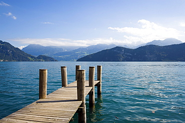 View from a wooden footbridge over Lake Lucerne with mountains in background, Weggis, Canton of Lucerne, Switzerland