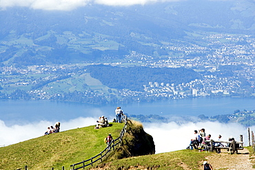 People on Rigi Kulm (1797 m) enjoying view over Lake Lucerne to Pilatus (2132 m), Rigi Kulm, Canton of Schwyz, Switzerland