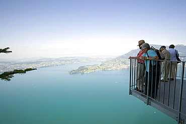 People standing at vantage point of Felsenweg and looking over Lake Lucerne, Buergenstock (1128 m), Buergenstock, Canton Nidwalden, Switzerland