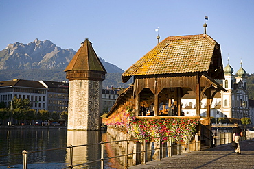 River Reuss with Kapellbruecke (chapel bridge, oldest covered bridge of Europe) and Wasserturm, Jesuit church, first large sacral baroque building in Switzerland, Pilatus in background, Lucerne, Canton Lucerne, Switzerland