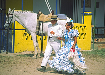 Spain, Andalucia, El Rocio, horse rirs in flamenco style at whitsan festival