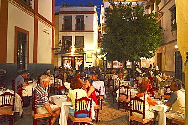Evening in Barrio Santa Cruz, Boga, Sevilla, Spain
