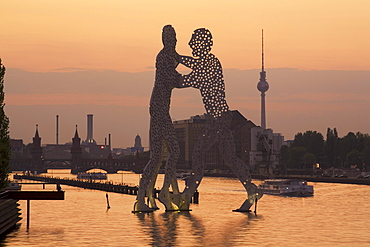 Molecular Men sculpture at River Spree with Alex TV Tower in Background, Berlin, Germany