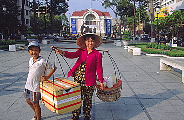 Saleswoman with child, Saigon, Ho Ch Ming City, Vietnam