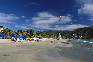 Beach life at Playa la ropa, Zihuatanejo, Guerrero, Mexico, America