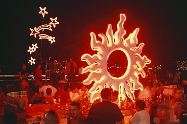 People celebrating in Latino Bar an Playa Icacos, Acapulco, Mexico