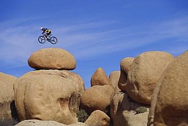 Extreme Mountainbiking, Mountainbiker in mid-air, Rocks, Rocky Landscape, Sport
