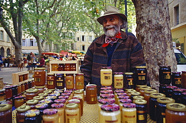 Local man selling honey at a market, Aix-En-Provence, Bouches-du-Rhone, Provence, France
