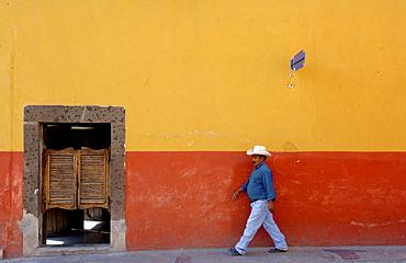 Mexican in front of a bar, San Miguel de Allende, Mexico