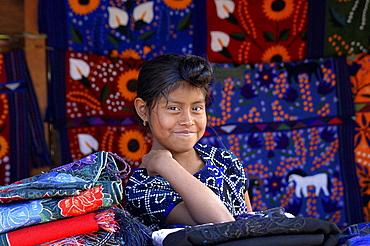 Mexican girl in a woven fabric store in San Lorenzo Zinacantun, Mexico