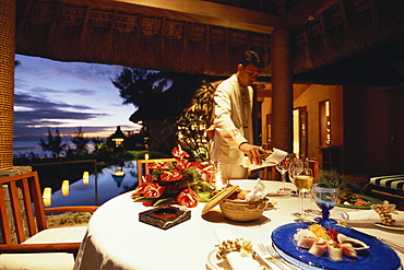 Waiter serving wine for a private dinner, Royal Villa, Hotel Oberoi, Holiday, Mauritius, Africa