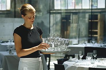 A waitress carrying glasses in Restaurant Lasalle, Zurich, Switzerland