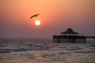 Sunset and the pier of Fort Myers Beach, Florida, USA