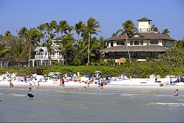 Municipal beach and homes in Naples, Florida, USA