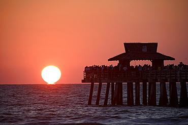 sunset at municipal pier of Naples, Florida, USA
