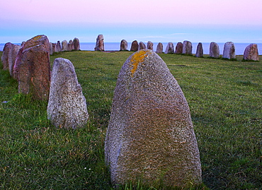 Ales stenar biggest old stone circle in form of a ship in Scandinavia near Kaseberga after sunset, Skane, Sweden