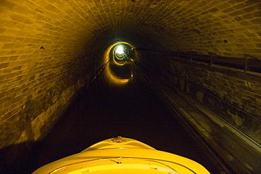 Houseboat in Niderviller Boat Tunnel, Crown Blue Line Calypso Houseboat, Canal de la Marne au Rhin, near Arzviller, Alsace, France