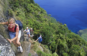 People climbing onto Mt. Gower, Lord Howe Island, Australia