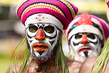 Men with facial painting at Singsing Dance, Lae, Papua New Guinea, Oceania