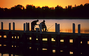 Fishermen on the jetty at sunset, Lakes Entrance, Victoria, Australia