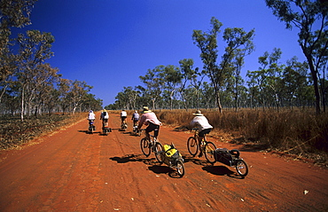 Cyclists on the road to Drysdale River Station, Gibb River Road, Western Australia, Australia