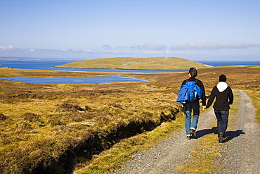 A man ansd a woman, a couple walking hand in hand, Island of Bressay near Lerwick, Shetland Islands, Scotland, Great Britain, UK