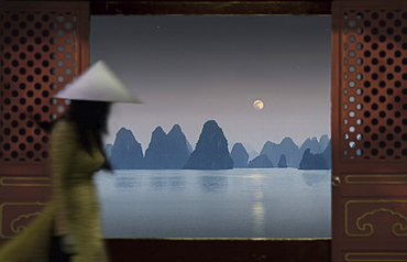 View from a Chinese junk, Chinese woman walking by, Halong Bay, Halong Bay, Vietnam, Indochina, Asia