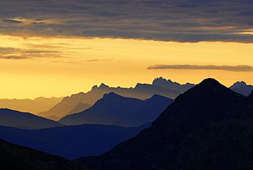 backdrop scenery of Dolomites at sunrise from hut Flaggerschartenhuette, Marburg-Siegener Huette, Rifugio Forcella di Vallaga, Sarntal range, South Tyrol, Alta Badia, Italy