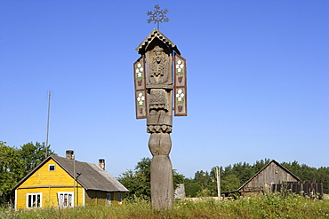 Carved wooden pole decorates farmhouses in the district of Druskininkai, Lithuania