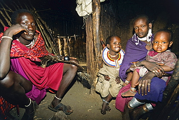 Massai family in her traditional house, Tanzania, East Africa