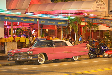 A vintage car on Collins Avenue in the evening, Miami Beach, Florida, USA