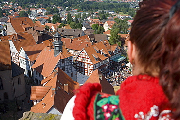 Woman in Traditional Costume Looking at Timberframe Houses in Schlitz, View from Schlitz Tower, Schlitz, Vogelsberg, Hesse, Germany