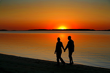 A couple enjoying the sunset, Wellfleet Harbor, Cape Cod, Massachusetts, USA