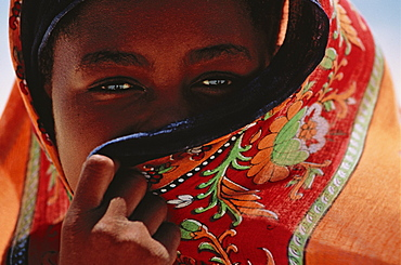 Muslim girl behind colorful veil, Bwejuu, Unguja, Zanzibar, Tanzania, Africa