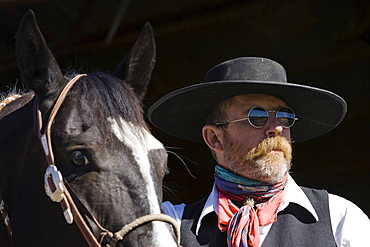 cowboy with horse at stable, wildwest, Oregon, USA