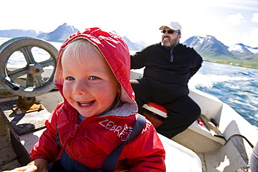 A little girl, child, and man on a fishing boat, Austvagoya Island, Lofoten, Norway
