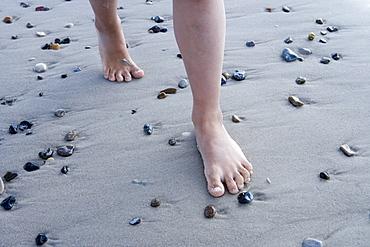 Girl Walking Along Henne Strand Beach, Henne Strand, Central Jutland, Denmark