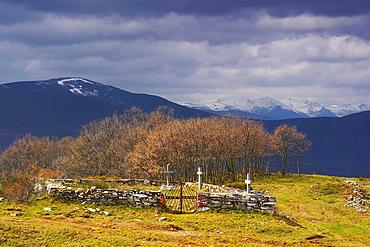 Cemetery in the village of Manjarin, with snow on the distant mountain range, Montes de Leon, Puerto de Rabanal, Castilla Leon, Spain